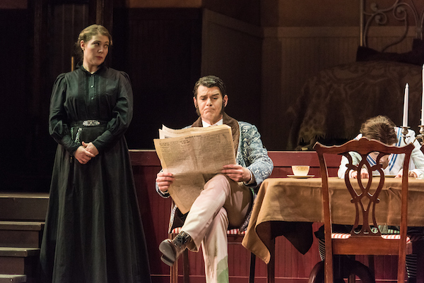 opera makeup woman and man reading newspaper